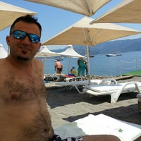 Photo taken at Pause Beach by Ercan on 7/24/2013