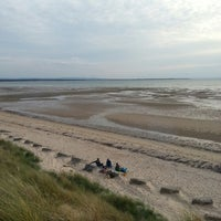 Photo taken at Burghead Beach by John F. on 7/13/2013