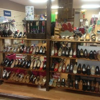 Photo taken at Struts Shoe Store by Brittany B. on 5/20/2013