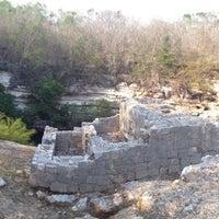 Photo taken at Cenote Sagrado by E. M. on 3/31/2013