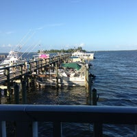 Photo taken at Mulligan's Beach House Bar & Grill by Lisa S. on 7/8/2013