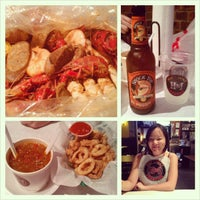 Photo taken at Hot N Juicy Crawfish by Jennie T. on 5/31/2013