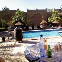 Photo taken at Kasbah Tizimi Hotel Erfoud by Joop K. on 5/2/2013
