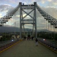 Photo taken at Puente Colgante Libertador (Monumento Nacional) by Adiak A. on 1/3/2014