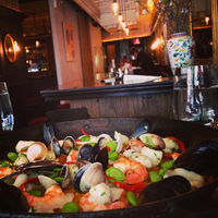 Photo taken at Socarrat Paella Bar by NYCRestaurant .. on 7/18/2014