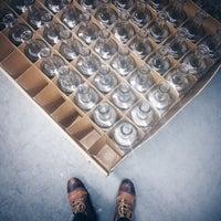 Photo taken at GrandTen Distilling by Caitlin C. on 11/6/2014