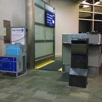 Photo taken at Gate C5 by Robin R. on 5/28/2014
