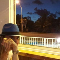 Photo taken at Cracked Conch Cafe by Sam O. on 5/24/2015