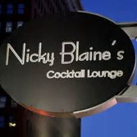 Photo taken at Nicky Blaine's Cocktail Lounge by Kelby D. on 4/13/2013