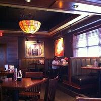 Photo taken at Houlihan's Restaurant + Bar by Stefan H. on 10/7/2012