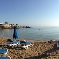 Photo taken at Pernera Beach by Anastasia R. on 8/28/2013