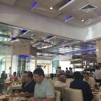 Photo taken at Olivos Restaurant by Brian R. on 9/4/2015