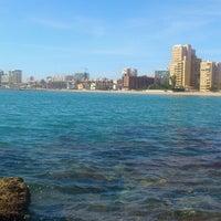 Photo taken at La Pobla de Farnals Beach by Erika B. on 4/12/2013