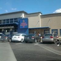 Photo taken at Regal Cinemas Potomac Yard 16 by Kimeko T. on 9/23/2012