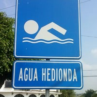 Photo taken at Balneario Agua Hedionda by Christopher G. on 10/6/2013