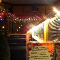 Photo taken at Atomic Cafe by Elizabeth F. on 12/12/2012