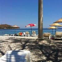 Photo taken at Yeşim Beach & Restaurant by Bülent Ö. on 7/28/2013