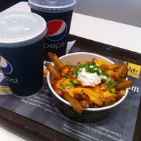 Photo taken at New York Fries by Willy on 4/4/2013