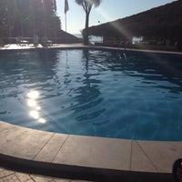 Photo taken at MARTINI swimming pool by Tamri K. on 7/22/2014