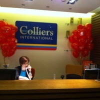 Photo taken at Colliers International by Sofya A. on 2/14/2014