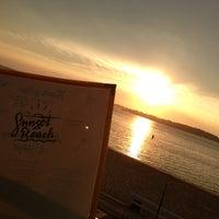 Photo taken at Sunset Beach by Sebastien L. on 6/16/2013