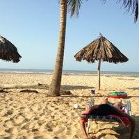 Photo taken at Playa de Boca de Uchire by Luis T. on 4/6/2013