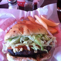 Photo taken at Red Robin Gourmet Burgers by Andrea M. on 4/21/2013