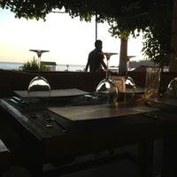 Photo taken at Buzz Beach Bar by Burcu Ö. on 8/5/2013