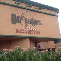 Photo taken at Oregano's Pizza Bistro by Davin M. on 7/23/2013
