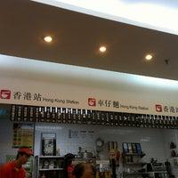 Photo taken at Hong Kong Station by Grace B. on 6/24/2013
