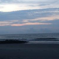 Photo taken at Pawleys Island Beach by Anita B. on 7/28/2013
