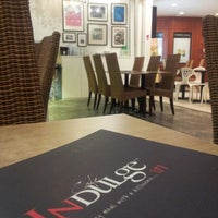 Photo taken at Cafe Indulge by Chin Han T. on 10/15/2012