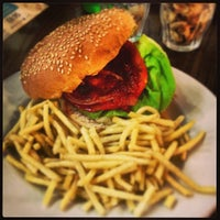 Photo taken at Gourmet Burger Kitchen by Raymond M. on 6/27/2013