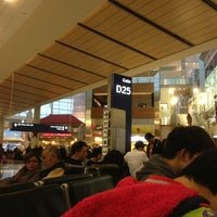 Photo taken at Gate D25 by PoP O. on 12/21/2013