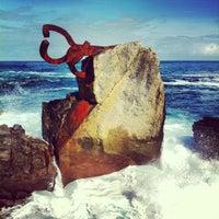 Photo taken at Peine del Viento by Auxi B. on 10/13/2012