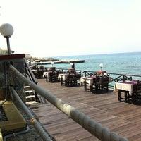 Photo taken at Calamari Restaurant by Dmitry G. on 5/31/2013