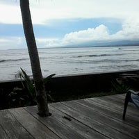 Photo taken at Tanjung Setia Surf Beach by Riri C. on 5/17/2013