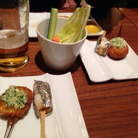 Photo taken at 串の坊 あべのハルカスダイニング店 by Mayumi Y. on 2/8/2014