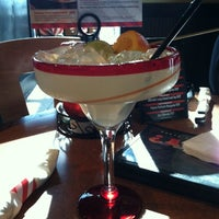 Photo taken at TGI Fridays by Stephanie K. on 12/28/2011
