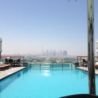 Photo taken at Hilton Dubai Roof Pool by Kh A. on 5/11/2013