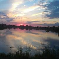 Photo taken at Озеро «Райдужне» by Eugene V. on 5/29/2013