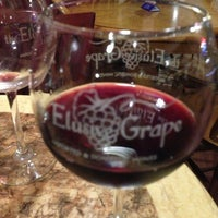 Photo taken at Elusive Grape by Nando M. on 6/8/2013