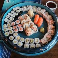Photo taken at Blue C Sushi by Derek E. on 5/3/2013