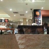 Photo taken at glo London Bakery Café by Yuan X. on 9/22/2013
