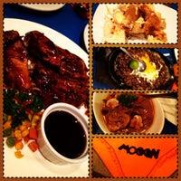 Photo taken at Mooon Cafe by JemJem R. on 4/18/2013