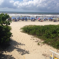Photo taken at Praia by Hector B. on 1/26/2014