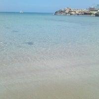 Photo taken at Pernera Beach by Julianne on 4/23/2013