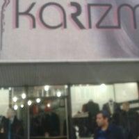 Photo taken at KARİZMA GİYİM by Turhan A. on 3/15/2014