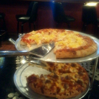 Photo taken at Glass Nickel Pizza Co. - Appleton by Gabe R. on 4/1/2013