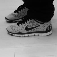 Photo taken at Nike Factory Store by Grace B. on 4/4/2013